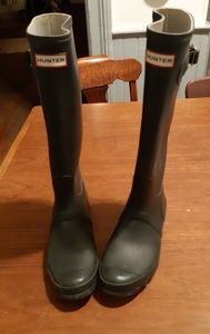 Hunter green tall boots.